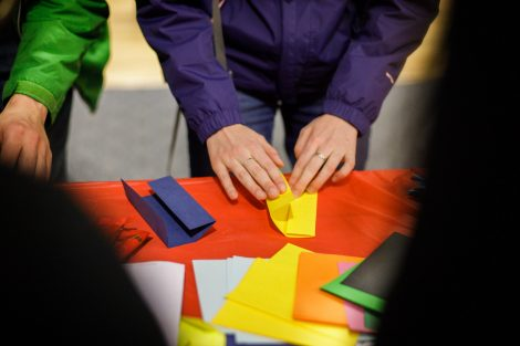 A student folds paper for origami at the Lunar New Year celebration.