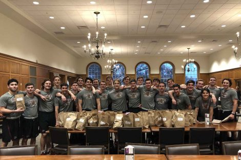 The team filled brown bags with needed canned goods during Hunger and Homelessness Awareness Week.