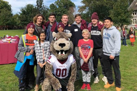 Lacrosse players meet with school students selected to attend Landis Day.