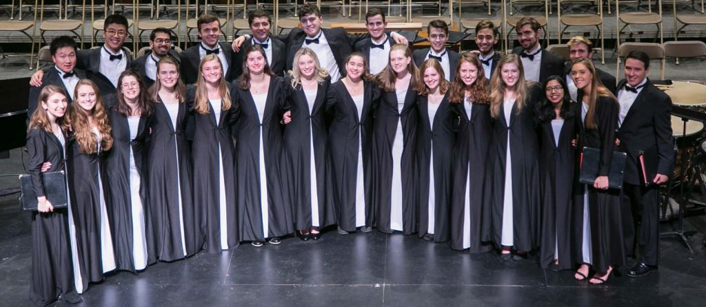 Lafayette Chamber Singers stand for a photo on stage