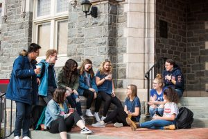 students sitting in front of hogg hall