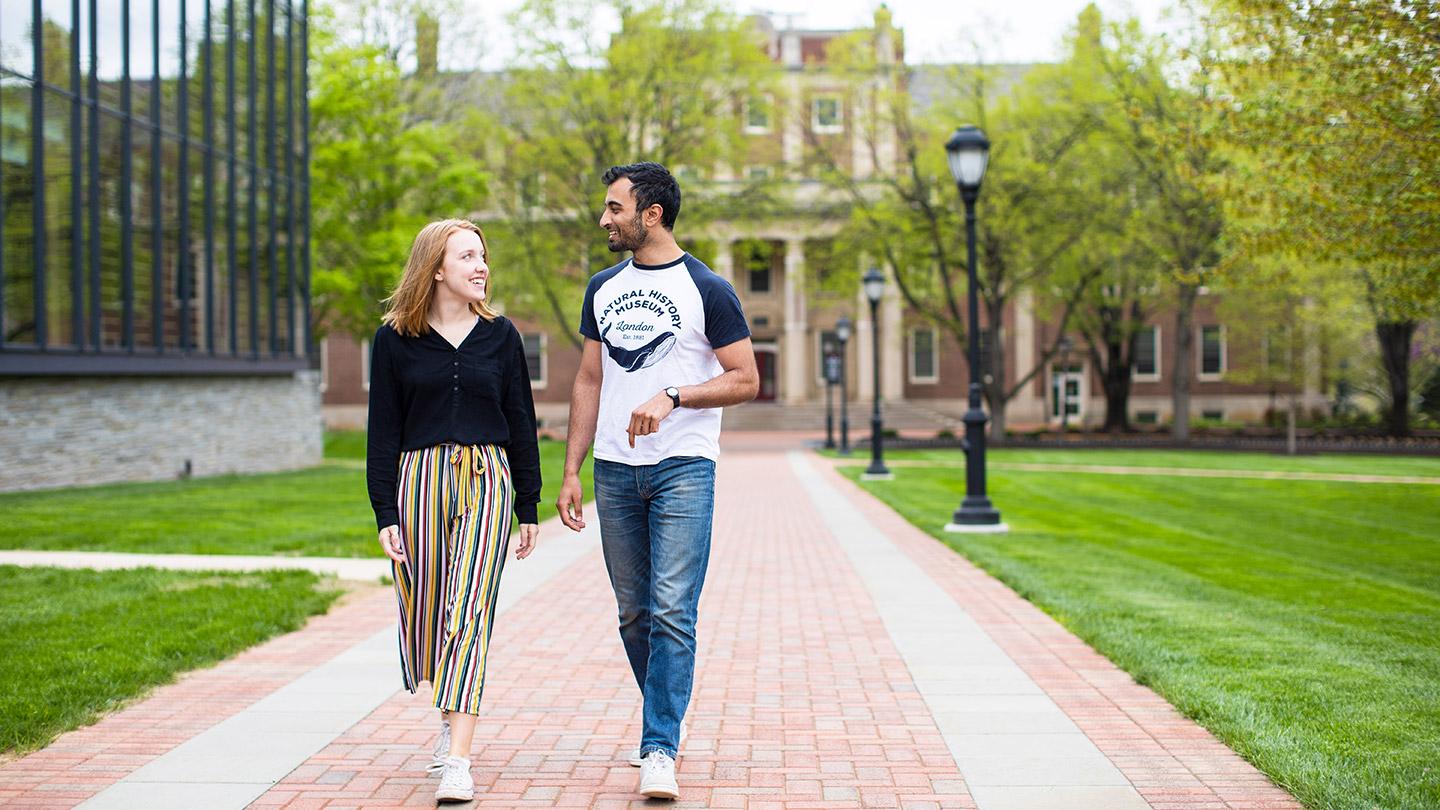 Jackie Cobb '19, who won a Fulbright scholarship to teach English at a school in India, walks across campus with her boyfriend.