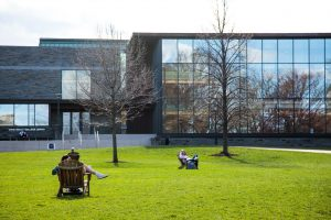 students study, sit, and play on the quad during a brief vision of spring