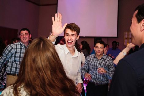 A student gives a high-five at the annual President's Ball.
