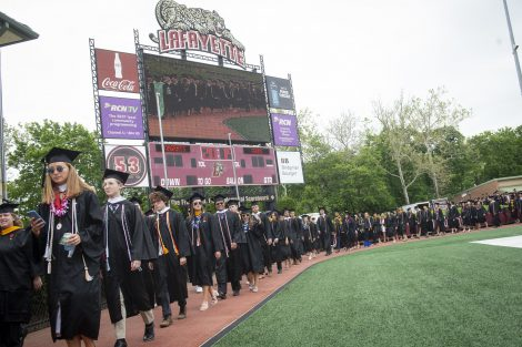 Graduates walk on the track around Fisher Field at Lafayette's 184th Commencement.