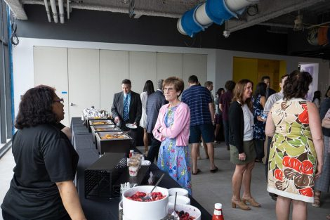 Guests talk at a biology department brunch hosted at Rockwell Integrated Sciences Center on Commencement morning.