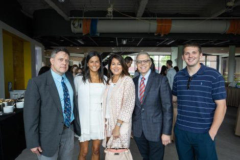 Professor James Dearworth poses with guests at a biology department brunch hosted at Rockwell Integrated Sciences Center on Commencement morning.