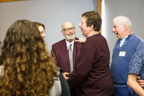 Retiring history professor Bob Weiner greets guests at his retirement party.