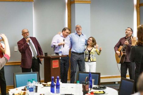 Retiring history professor Bob Weiner sings at his retirement party.