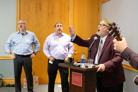 Retiring history professor Bob Weiner sings at his retirement party.