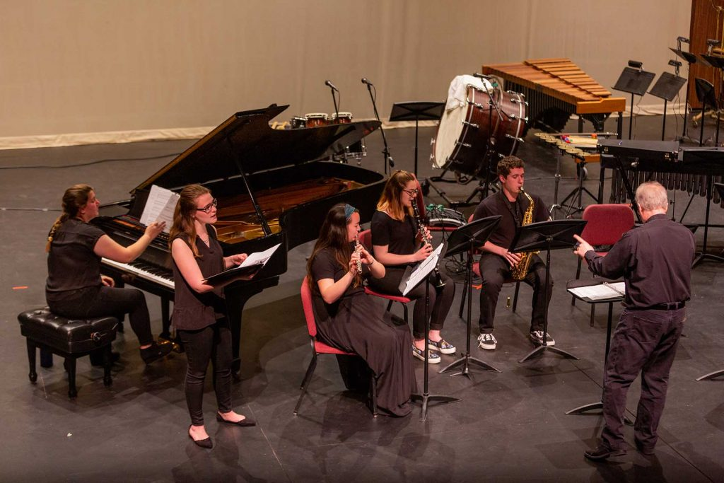 Singer and musicians perform in the Contemporary Music Ensemble
