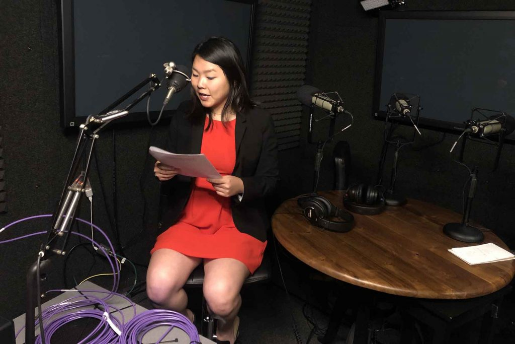 Student records her voice over in the PBS39 studios.