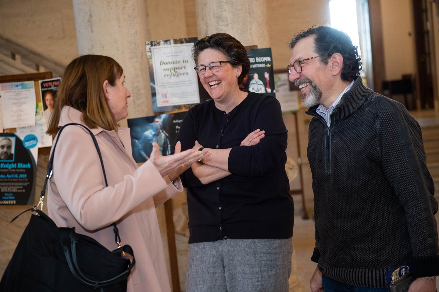 President Alison Byerly and Professor Mary Armstrong talk with an attendee at the reception for the launch of the Queer Archives Project.
