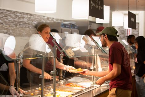 Students chow down on breakfast food late at night, served up by faculty and staff.