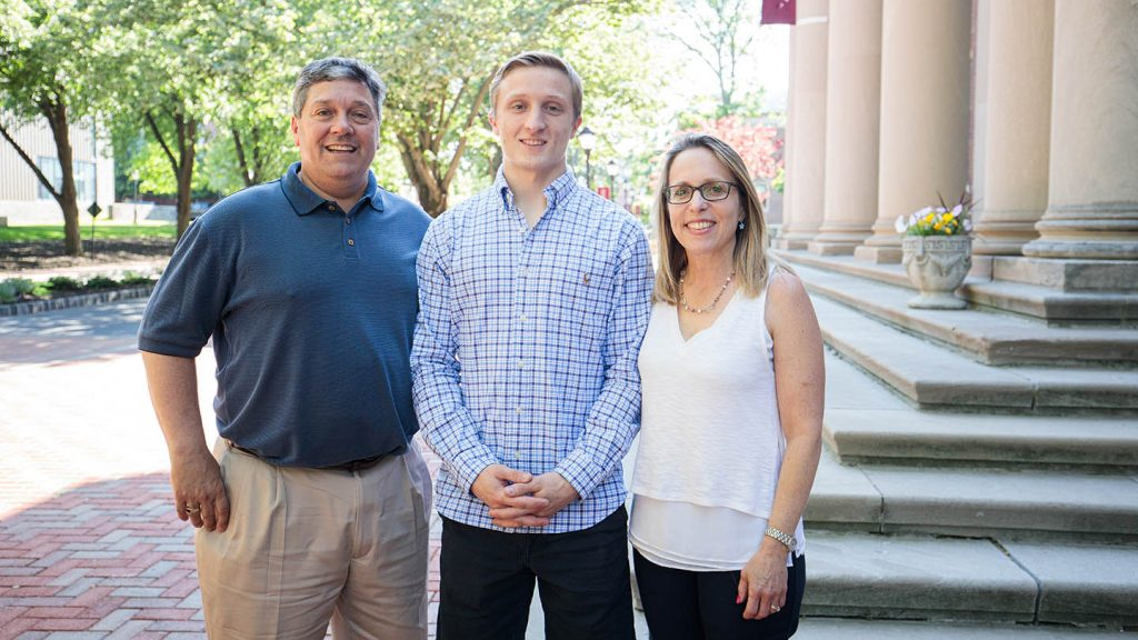 Scholarship winner Christian Combi with his parents Cynthia and Mark.