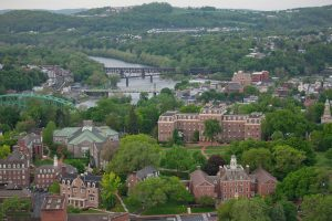 An aerial view of Lafayette College's campus and the river behind it