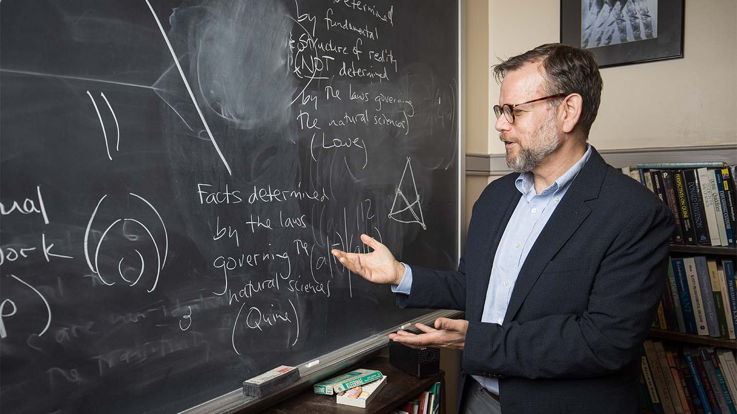 Prof. Joe Shieber, who was tapped to teach a video and audio course for The Great Courses, teaches at the front of a classroom.