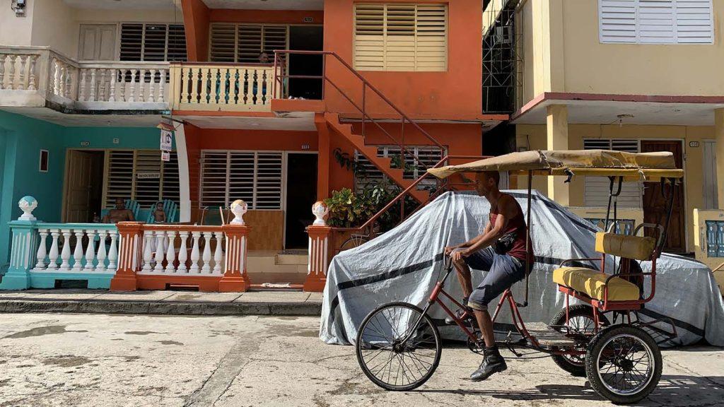 Lucie Lagodich took a photo in Cuba of a man on a bike.