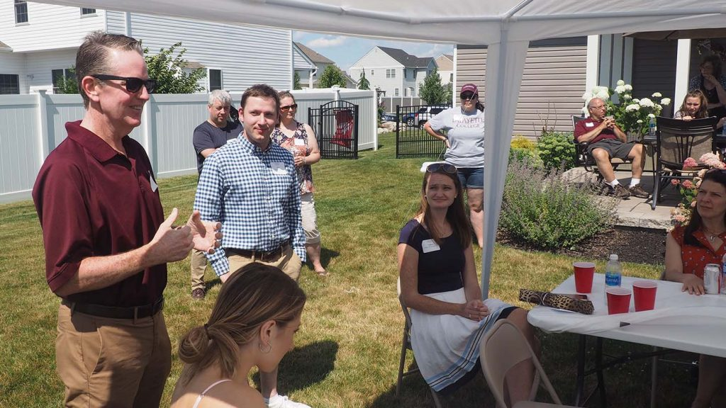 Greg MacDonald, vice president for enrollment management, speaks to incoming students and their families at a Welcome Event hosted by alums in Easton.