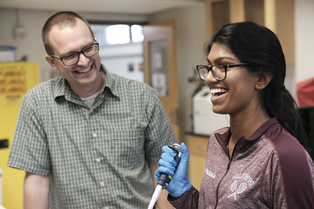 High school student Trisha Pakkala shares a laugh with Prof. Van Horn