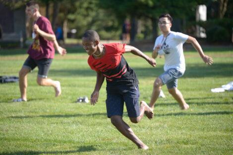 international student runs on quad