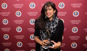 Megan Fernandes holds her Hoff Award during the event.