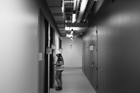 Turner Construction employee checking rooms in Rockwell Integrated Sciences Center