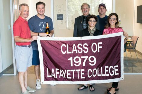 Alumni hold the Class of 1979 banner.