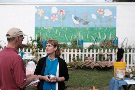 President Alison Byerly talks to Professor Larry Malinconico