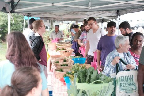Residents get produce at the Farm Stand run by the Vegetables in the Community program.