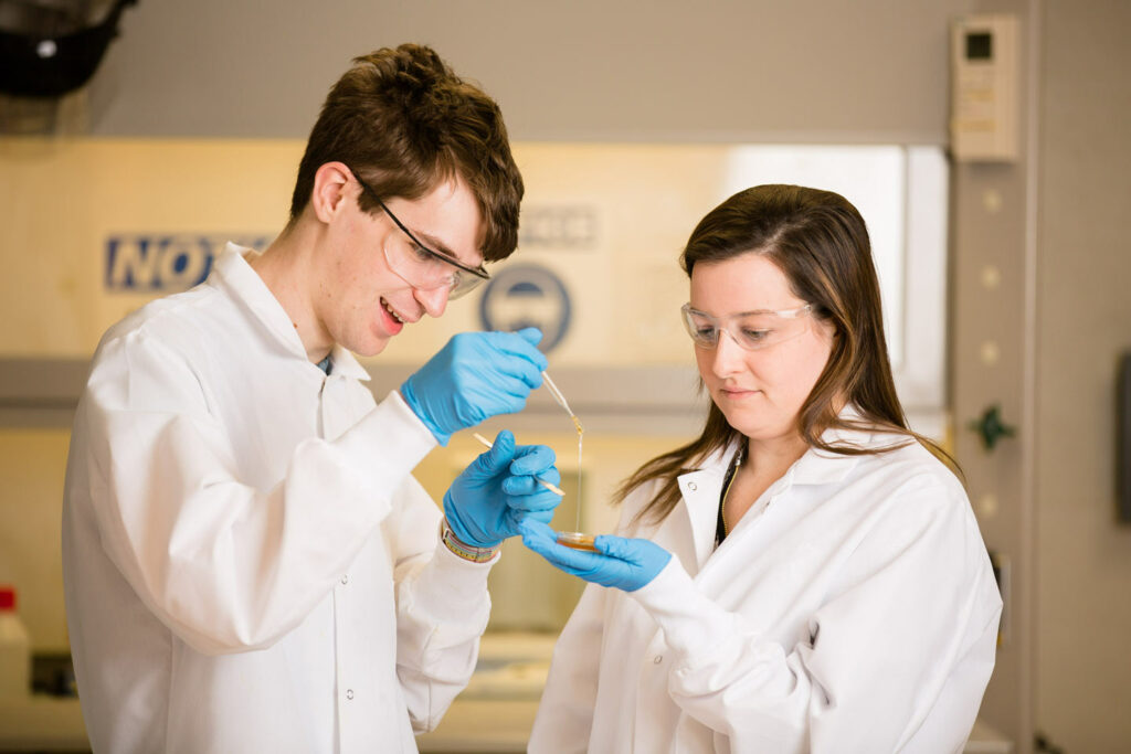 Clark Addis '20 and Professor Melissa Gordon do research on a polymer in the Lafayette Polymers Laboratory.