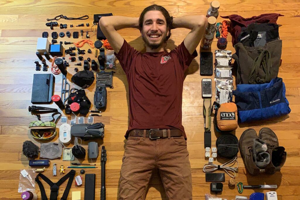 Remy Oktay '23 takes a selfie of him and all the gear he packed for his gap year