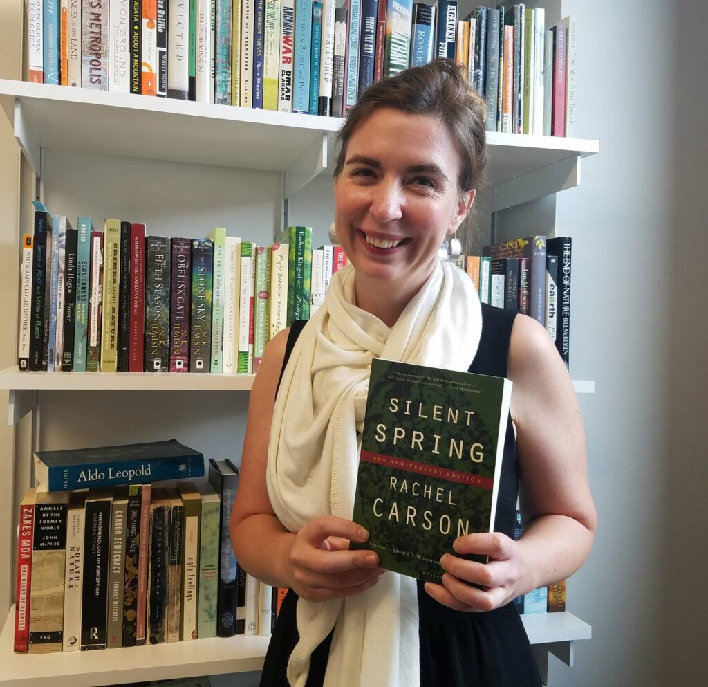 Sarah Dimick holds the book Silent Spring by Rachel Carson