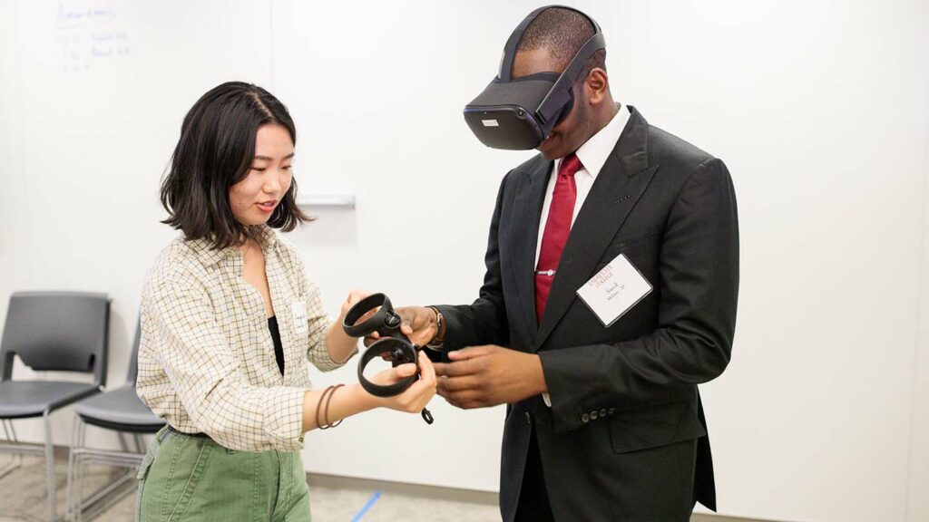 Students demonstrate virtual reality technology at Rockwell opening