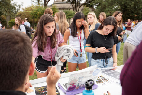 Students meeting with clubs and organizations on the quad during the activities fair