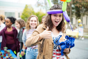 A student wears a balloon hat at Block Party