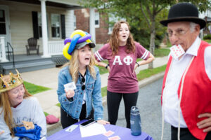 a student is fooled by a magic trick at block party