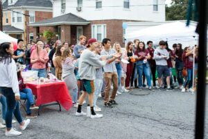 students clap for performers at block party