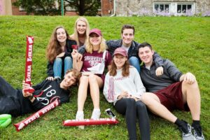 a friendgroup of students smiles for the camera at block party