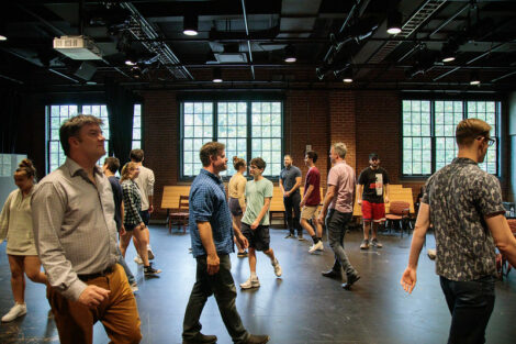 Members of Improvised Shakespeare Company have students and staff walking around during a workshop.