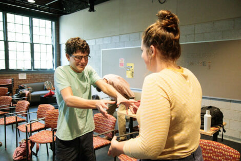 Two students interact during a workshop led by Improvised Shakespeare Company.