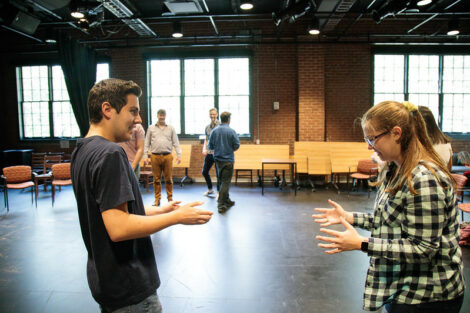 Two students interact during a workshop held by Improvised Shakespeare Company