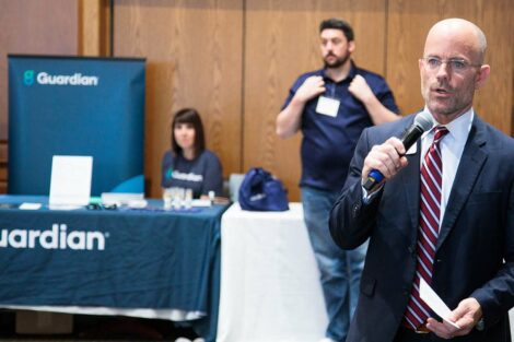 Mike Summers speaks to people at Career Fair
