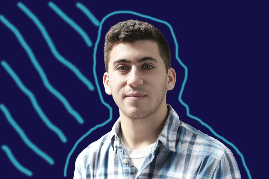 Image of Dan with blue background and blue slanting lines