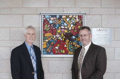 Art Kney and Bill Landis stand before the mosaic