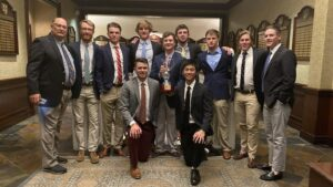 Members of the men's golf team pose with the trophy earned by winning the President's Cup against Lehigh.