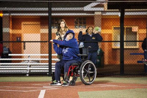 Man in wheelchair swings at pitch