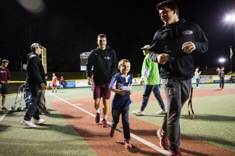 Young player runs toward homebase