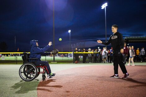 Lafayette player throws ball to boy in wheelchair