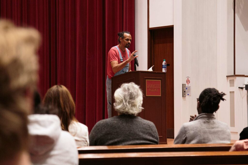 Ross Gay '96 on stage in Colton Chapel
